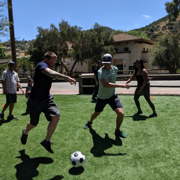 Some AV-ators playing soccer at the 2019 company picnic.