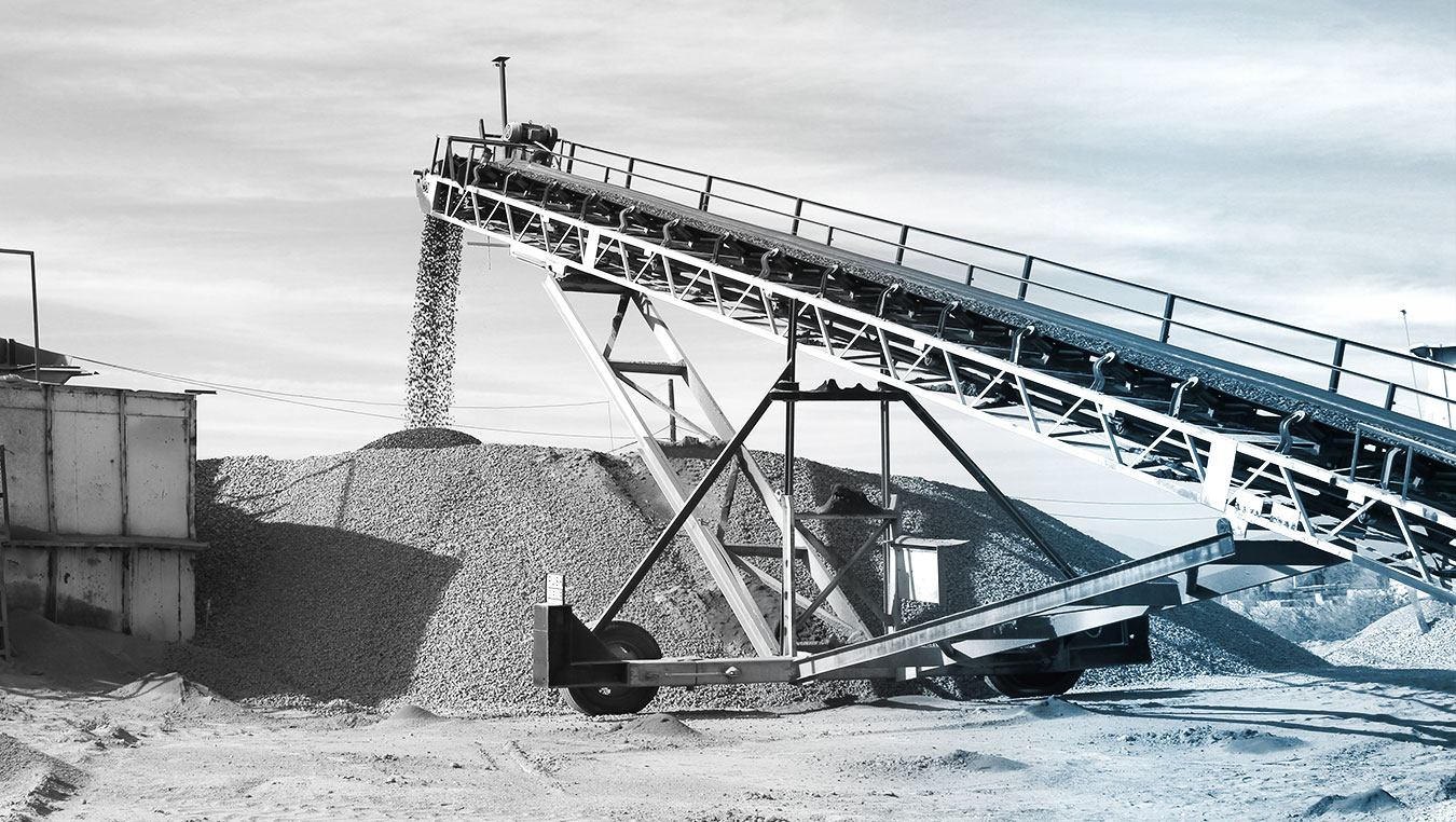 Conveyor belt creating an asphalt aggregate stockpile from an aggregate crushing plant on the IA/RSP project