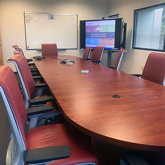 Alta Vista's Sacramento office conference room with smartboard